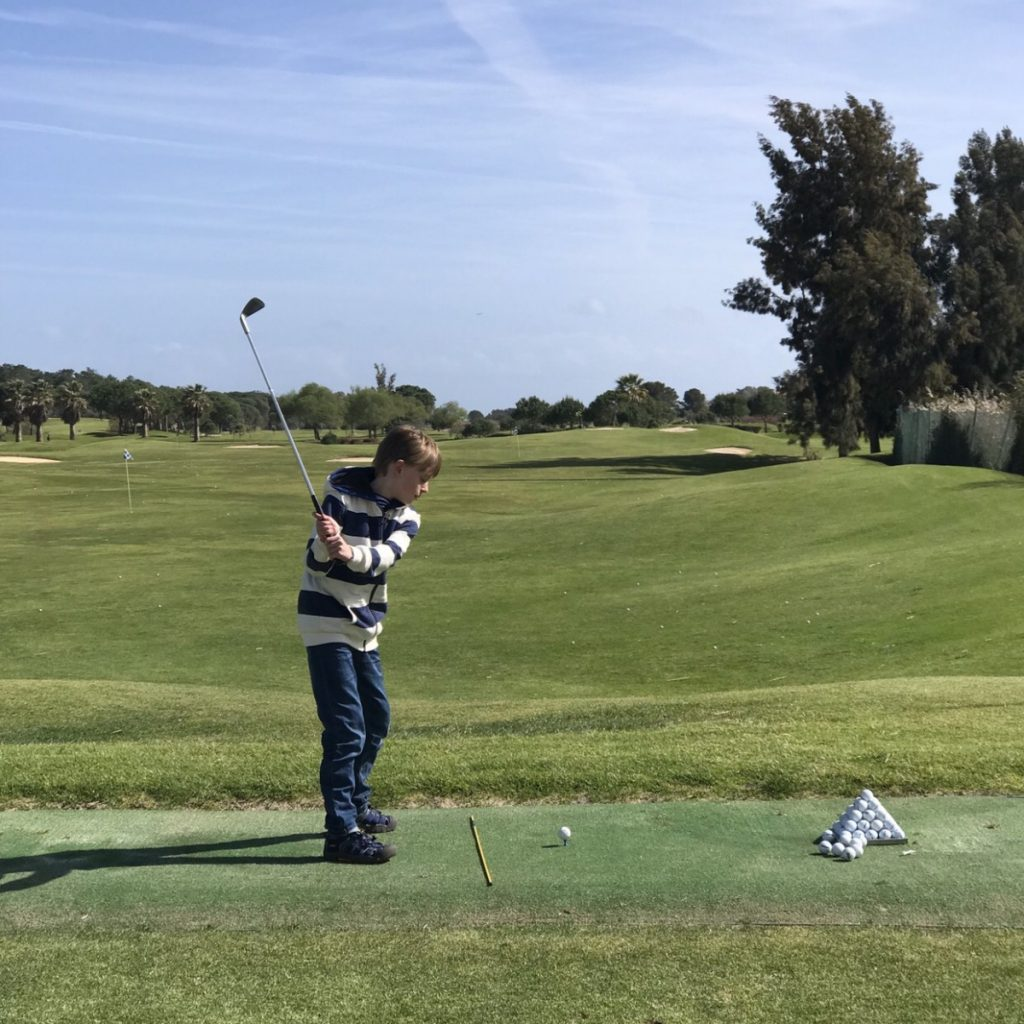 Learning to play golf - 10 top things to do in Algarve with kids - copyright: www.globalmousetravels.com